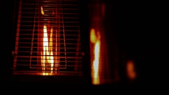 Fire Burning Inside Contemporary Metallic Decorative Lamps in Dark Stock Footage