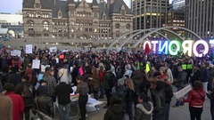 Protestors against Donald Trump's election win at Nathan Phillip Square, Toronto Stock Footage