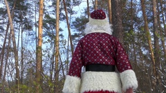 "Santa Claus show to you big finger - ""Like"" from the back. Stock Footage"