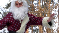 "Santa Claus show to you big finger - ""Like"" in the forest. Stock Footage"
