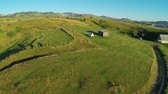 AERIAL view of countryside village and farmlands, flight above country roads Stock Footage