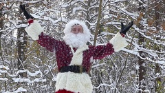 Santa Claus in the forest during snow falling. Slow motion. Stock Footage