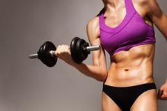 Woman with dumbbell fit slim abs body Stock Photos