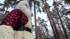 Walking of Santa in the forest at slow motion. Stock Footage