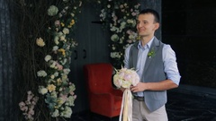Groom waits for bride to hand her wedding bouquet Stock Footage