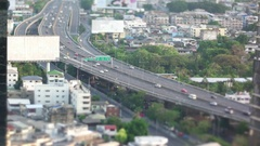 Aerial view of Road traffic on Sirat Expy Road with miniature effect Stock Footage