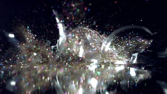 4K Christmas Abstract Background of Glitter in Glass Ball Falling in Pieces Stock Footage