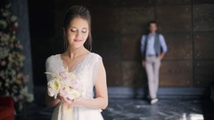 Bride in white dress dress waiting for groom in wedding day indoor Stock Footage