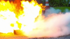 Fire extinguished by chemical substance in firefighter Stock Footage