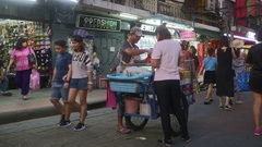 Street vendor sells tropical fruits on the Khao San Road Stock Footage