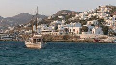 Sailing boat and view towards the new old port of chora, mykonos Stock Footage