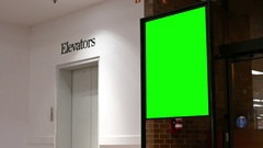 Green billboard for your ad beside elevators with 4k resolution. Stock Footage