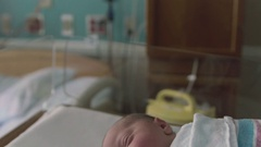 Cute 1 Day Old Newborn Baby in Hospital Delivery Room Bed Sticking Tongue Out Stock Footage