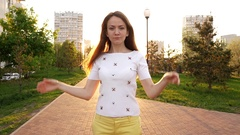 Woman portrait, lady rise hands to put long hair on shoulders, ironic lofty mood Stock Footage
