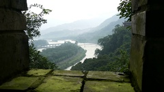 China - Dijiangyan irrigation system - Min river through wall Stock Footage