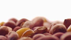 Spinning Pile of Roasted Peanuts in Dark Red Skins Stock Footage