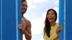 Surfing couple surfers showing thumbs up with surfboard on beach on Hawaii Stock Footage