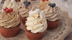 Delicious cakes with nuts and berries close up, wedding refreshments Stock Footage