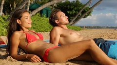Young couple relaxing after surfing on beach Maui, Hawaii Arkistovideo