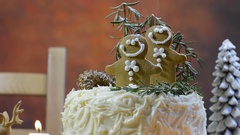 White chocolate Christmas cake decorated with gingerbread men cookies Stock Footage