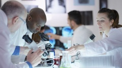 4K Happy scientific research team make a discovery in the lab Stock Footage