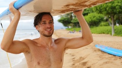 Sexy surfer man holding surf board after surfing Stock Footage