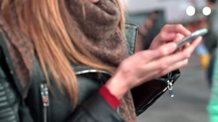 Closeup of woman's hands sliding on smartphone Stock Footage