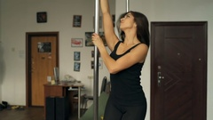 Beautiful young girl Pole dance in studio stock footage video Stock Footage