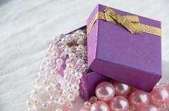 Gift with pink pearl strings and large pearls Stock Photos