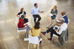 Business people talking in circle meeting Stock Photos