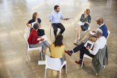 Business people talking in circle meeting Kuvituskuvat