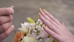 The offer to marry. Hands of the man dressing a ring on the beloved's finger Stock Footage