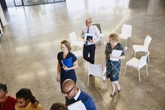 Business people leaving meeting circle Stock Photos
