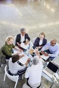 Business people handshaking in meeting Stock Photos