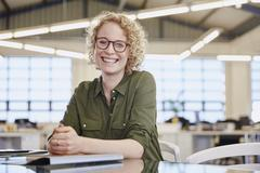 Portrait smiling businesswoman in office Stock Photos