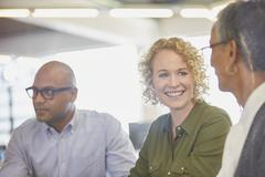 Businesswomen talking in office Stock Photos