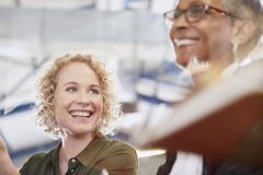 Smiling businesswomen in meeting Stock Photos
