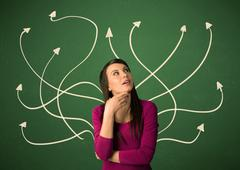 Young student with thoughtful expression with tangled arrows coming out of her b Stock Photos