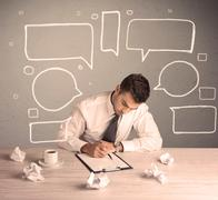 An intelligent elegant business person sitting at a desk and working with drawn  Stock Photos