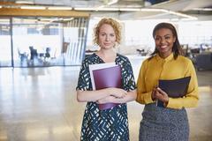 Portrait smiling businesswomen in office Stock Photos