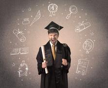 Happy graduate teenager with hand drawn school icons above his head Stock Photos