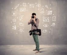 An amateur hobby photographer learning to use a professional digital camera Stock Photos