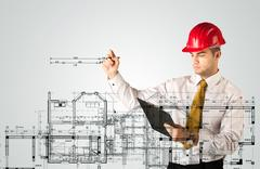 A young architect planning and drawing a family house layout Stock Photos