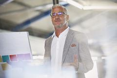 Businessman leading meeting Stock Photos