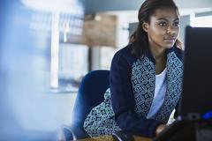 Businesswoman working at laptop in office Stock Photos