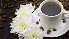 Chrysanthemum and coffe on the wooden table Stock Footage