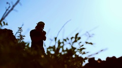 Silhouette of a man doing workout in the mountains Stock Footage