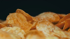 Potato Chips Rotating On Black Background Stock Footage