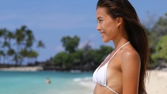 Beautiful serene asian beauty portrait of woman relaxing on tropical beach Stock Footage