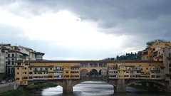 Arno River in the heart of the city. Ponte Vecchio (Old Bridge) Stock Footage